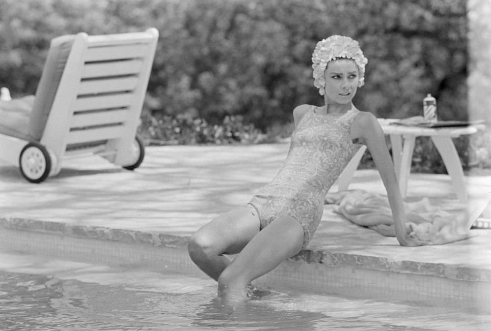 Woman in a swimsuit and hat in the pool
